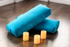 Bolster cushions and candles