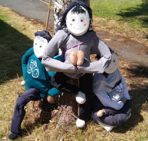Scarecrows in a Yoga pose during Lock down